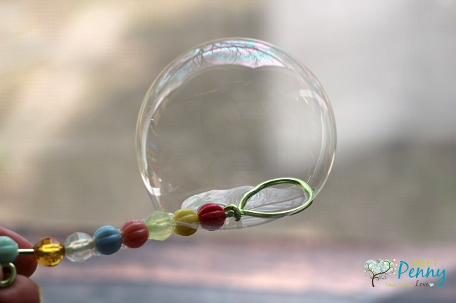 Missing bubble wand? No problem! Make an adorable but homemade bubble wand using items from the dollar store.
