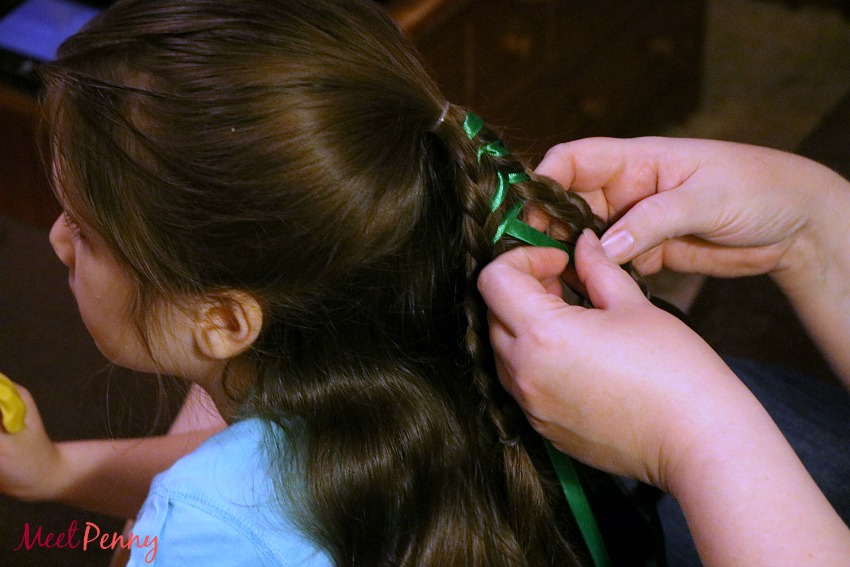 A super cute Christmas hairstyle for little girls. Use ribbon and ornaments in the Christmas Tree Braid Kit to create a sweet and simple Christmas braid.