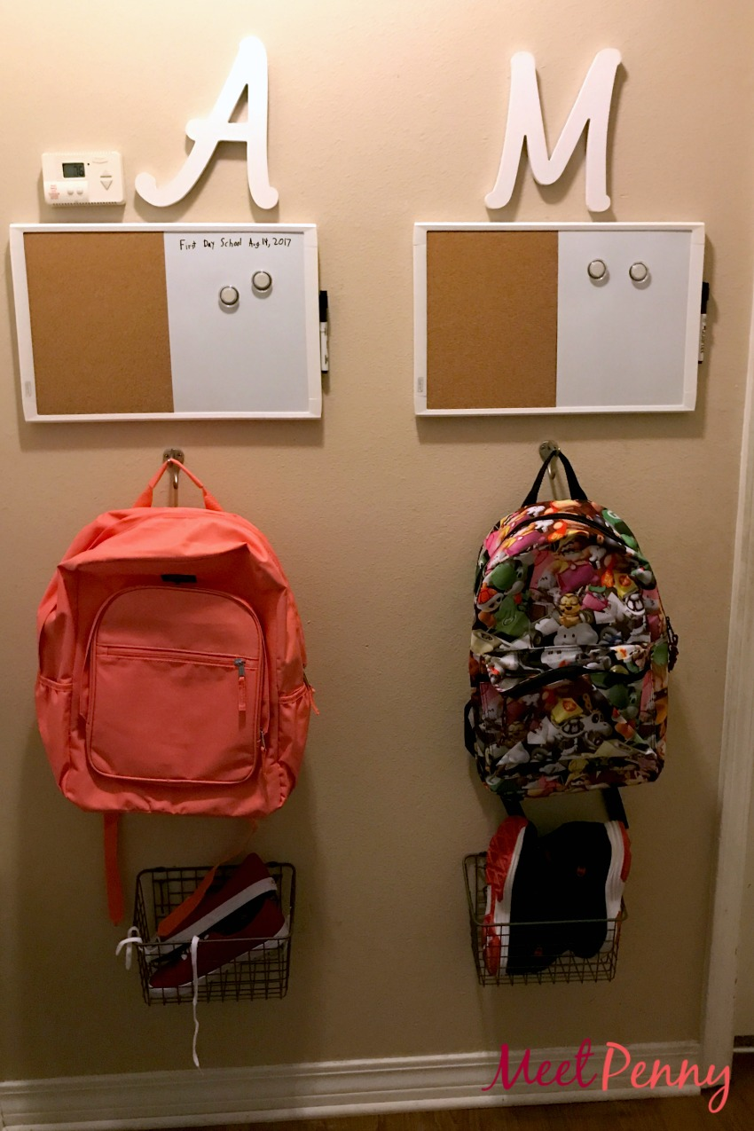 Back to school organization by creating a place for backpacks, shoes, and reminders for each child
