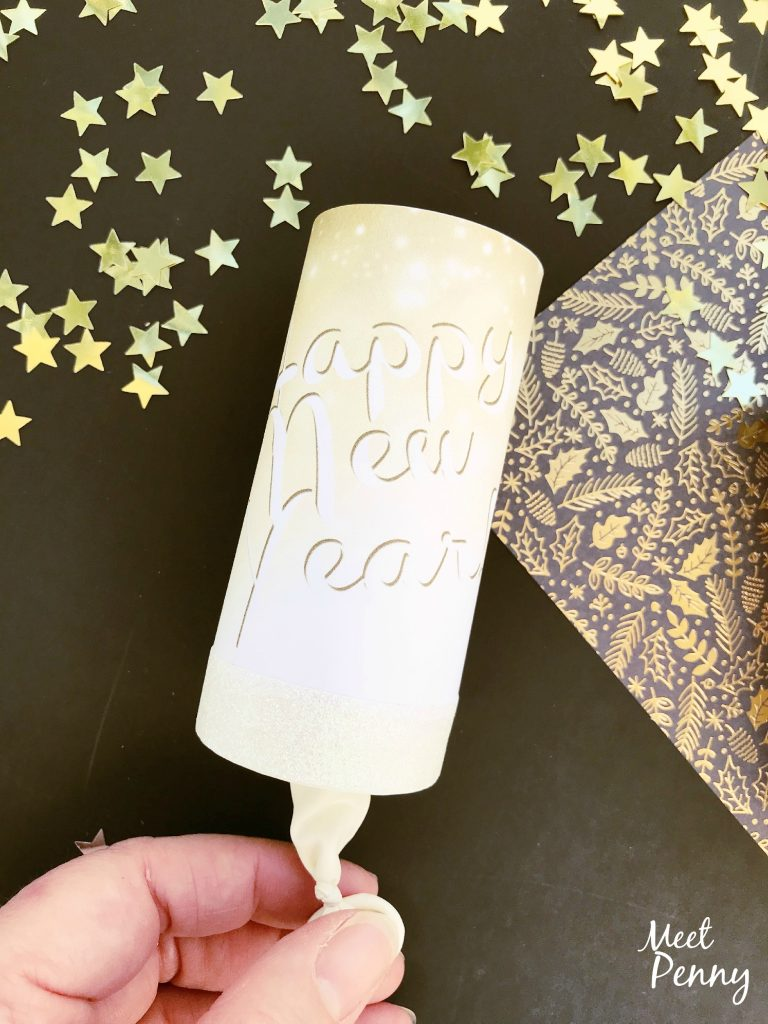 Super easy way to create a family friendly New Year's Eve. They will love these confetti cannons for kids. (Includes free printable wrapper)