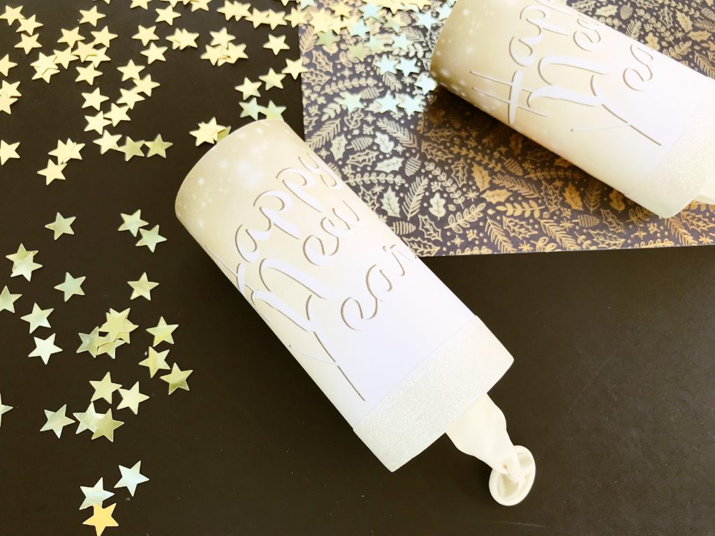 Super easy way to create a family friendly New Year's Eve. The kids will love these confetti cannons. (Includes free printable wrapper)